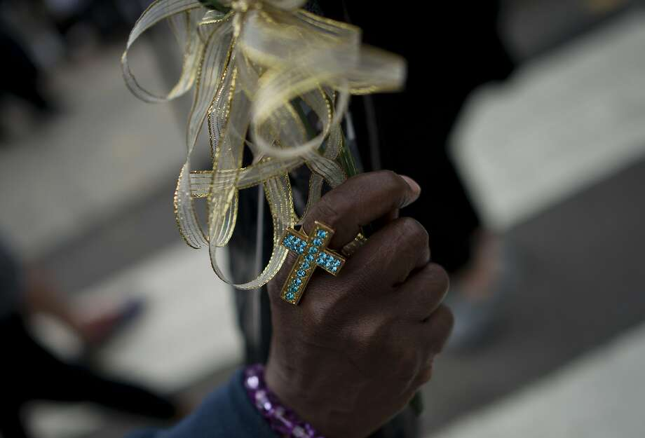 A woman holds a rosary during the Mass attended by hundreds of thousands on Benjamin Franklin Parkway. Photo: Andrew Caballero-reynolds, AFP / Getty Images