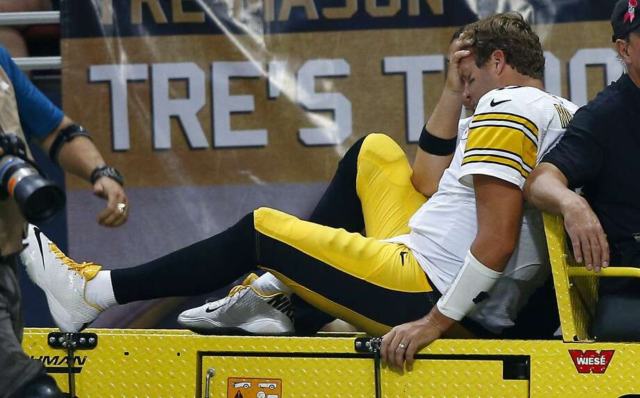 Pittsburgh quarterback Ben Roethlisberger is taken off the field on a cart after being injured during the third quarter. Photo: Billy Hurst, Associated Press