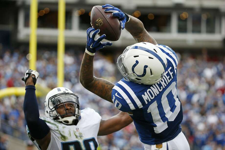 Indianapolis Colts wide receiver Donte Moncrief (10) catches an 11-yard pass for a touchdown as he is defended by Tennessee Titans defensive back Perrish Cox in the second half of an NFL football game Sunday, Sept. 27, 2015, in Nashville, Tenn. The Colts won 35-33. (AP Photo/Weston Kenney) Photo: Weston Kenney, Associated Press