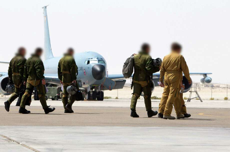 "This handout picture released on September 27, 2015 by French Defense Audiovisual Communication and Production Unit (ECPAD) shows French soldiers walking on the tarmac of a base in The Gulf, as part of France's Operation Chammal launched in September 2015 in support of the US-led coalition against Islamic State (IS). France carried out on September 27, 2015 its first air strikes against the Islamic State group in Syria, launching a military operation as Russia and Western powers sought the upper hand in shaping the future of the war-torn country. President Francois Hollande said six French warplanes hit an IS training camp near the eastern city of Deir Ezzor, and that more air strikes could follow in the coming weeks. AFP PHOTO / ECPAD     = RESTRICTED TO EDITORIAL USE - MANDATORY CREDIT ""AFP PHOTO / ECPAD"" - NO MARKETING NO ADVERTISING CAMPAIGNS - DISTRIBUTED AS A SERVICE TO CLIENTS - TO BE USED WITHIN 30 DAYS FROM 27/09/2015 =-/AFP/Getty Images Photo: -, Handout / AFP / Getty Images / AFP"