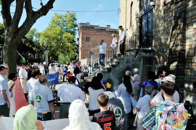Paul Stewart, on the left on stairs, co-founder of the Underground Railroad History Project, addresses those gathered outside the Israel AME Church during the North Star Peace Walk on Sunday, September 27, 2015, in Albany, N.Y.  The interfaith 1.5 mile walk took participants to various churches and war memorials, where speakers at each site spoke about peace in the world.    (Paul Buckowski / Times Union) Photo: PAUL BUCKOWSKI / 00033440A