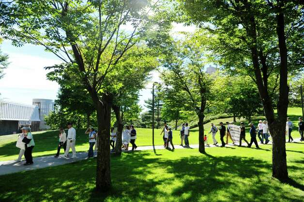 Walkers make their way through a park along Madison Ave. during the North Star Peace Walk on Sunday, September 27, 2015, in Albany, N.Y.  The interfaith 1.5 mile walk took participants to various churches and war memorials, where speakers at each site spoke about peace in the world.    (Paul Buckowski / Times Union) Photo: PAUL BUCKOWSKI / 00033440A