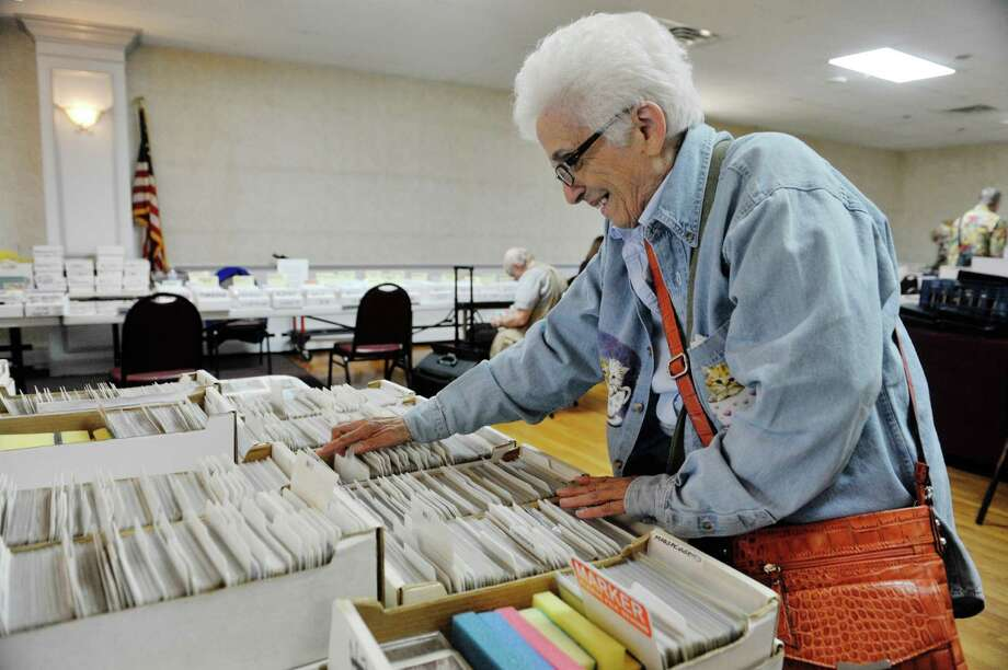 "Post card collector Elaine Frederick of Hinsdale, MA searches through cards at the 42nd Annual Upstate New York Post Card Club Show at the Elks Lodge #141 on Sunday, September 27, 2015, in Troy, N.Y.  Frederick has been collecting post cards for over 20 years.  The yearly event began in the 1970's in Amsterdam.  Today the club has 50 active members and Jim Smoak, club secretary, siad that the show is a way for the club to promote the hobby.  ""The great thing about post card collecting is that there are no bounds.  You buy one post card and then you start looking closer and you see things in the image and that leads you to investigate more about the scene.  You start to ask questions"", Smoak said.  (Paul Buckowski / Times Union) Photo: PAUL BUCKOWSKI / 00033439A"