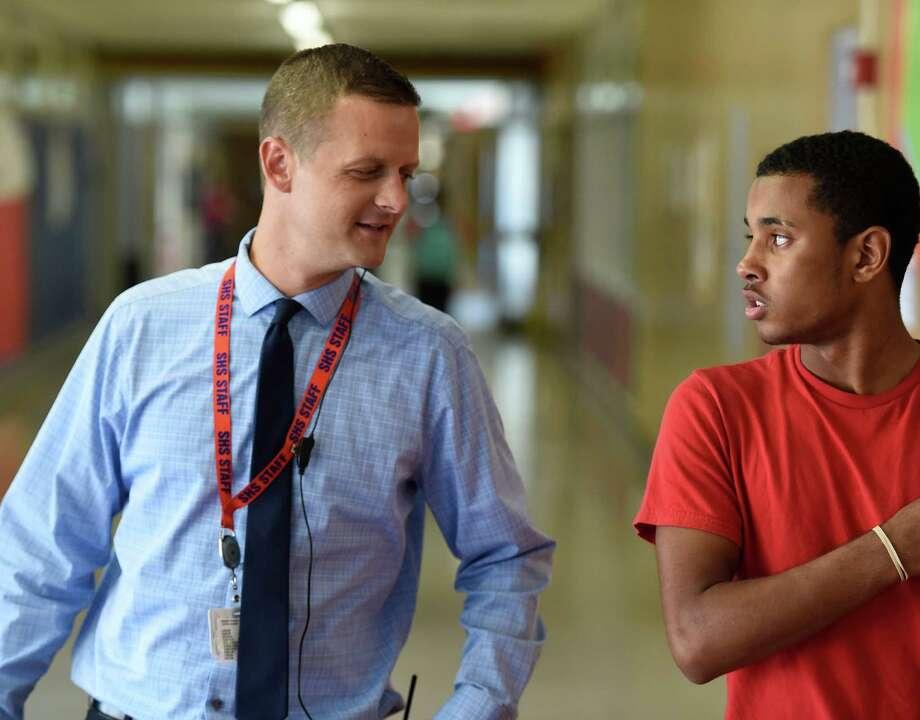 Jonathan Goyette works the hall of Schenectady High School Friday morning Sept. 18, 2015 in Schenectady, N.Y.     (Skip Dickstein/Times Union) Photo: SKIP DICKSTEIN