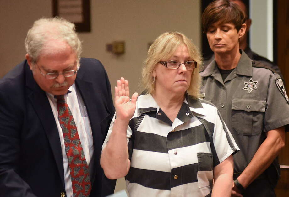 "In this July 28, 2015 file photo, Joyce Mitchell raises her hand during a court appearance in Plattsburgh, N.Y. Mitchell, the former New York prison employee who helped two killers escape from a maximum-security prison in June, said in an interview that aired Monday, Sept. 14, on NBC's ""Today"" show that she was depressed at the time and the inmates took advantage of what she called her ""weakness."" (Rob Fountain/The Press-Republican via AP, Pool, File)"