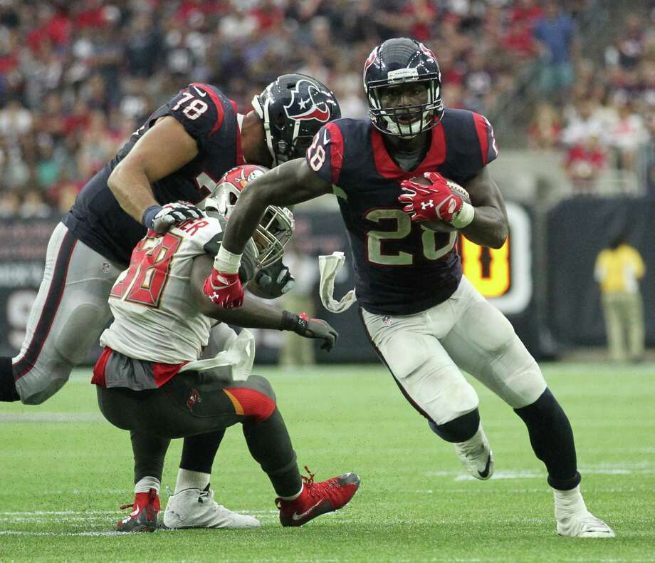 Houston Texans running back Alfred Blue (28) runs past the line of scrimmage in what would be a 20-yard touchdown run during the fourth quarter of an NFL football game at NRG Stadium on Sunday, Sept. 27, 2015, in Houston. ( Jon Shapley / Houston Chronicle ) Photo: Jon Shapley, Staff / © 2015  Houston Chronicle