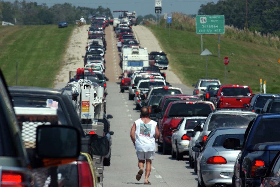 Bruce Crabtree, 49, of Pasadena, runs down the center of Northbound U.S.  96 in Silsbee on Sept. 22, 2005, as he tries to catch up with his family after traffic started to move. The highway  was clogged with Southeast Texas residents fleeing Hurricanae Rita. On this date in 2005, Tropical Storm Rita formed near Florida. Photo: SCOTT ESLINGER, MBR / THE BEAUMONT ENTERPRISE