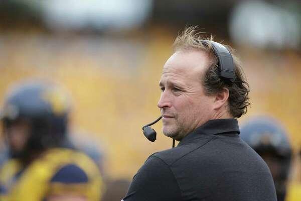 West Virginia head coach Dana Holgorsen during the first half/ second half of a NCAA college football game, Saturday, Sept. 26, 2015, in Morgantown, W.Va. (AP Photo/Raymond Thompson)