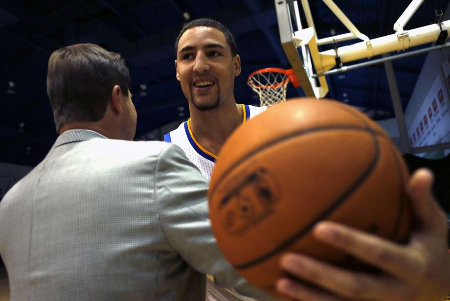 Golden State Warriors' Klay Thompson greets team owner Joe Lacob on media day in Oakland, Calif. on Monday, September 29, 2014. Photo: Scott Strazzante, The Chronicle