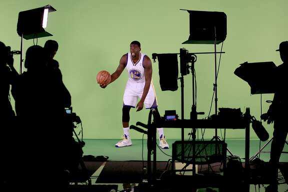 Draymond Green, (23) is filmed as the Golden State Warriors hold a media day at their practice facility in downtown Oakland, Calif. on Friday September 27, 2013.