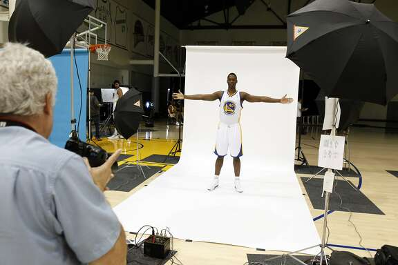 Harrison Barnes poses for a photo by NBA photographer, Steve Yeater, left, as the Golden State Warriors met with the press during their annual Media Day on Monday, October 1, 2012, at the team's Practice Facility in Oakland, Calif. Players discussed the upcoming 2012-13 NBA season.