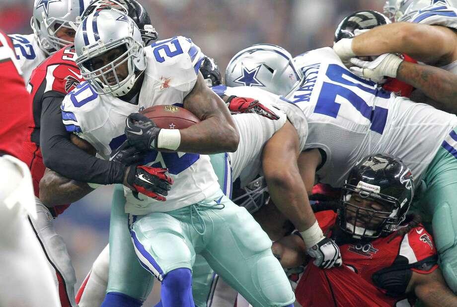 Dallas Cowboys  running back Darren McFadden is stopped by Atlanta Falcons defenders on Sunday, Sept. 27, 2015, at AT&T Stadium in Arlington, Texas. (Khampha Bouaphanh/Fort Worth Star-Telegram/TNS) Photo: Khampha Bouaphanh, MBR / McClatchy-Tribune News Service / Fort Worth Star-Telegram