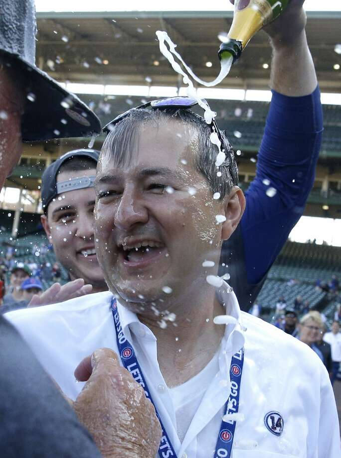 Anthony Rizzo (rear) pours champagne on team owner Thomas S. Ricketts. Photo: Nam Y. Huh, Associated Press