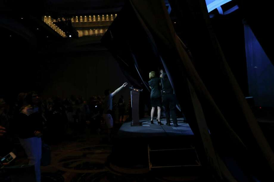 A curtain backdrop falls around GOP presidential candidate Carly Fiorina (center in green dress) as she speaks at the National Association of Women Business Owners 40th national conference Sunday Sept. 27, 2015 at the Marriott Rivercenter. Photo: Edward A. Ornelas, Staff / San Antonio Express-News / © 2015 San Antonio Express-News