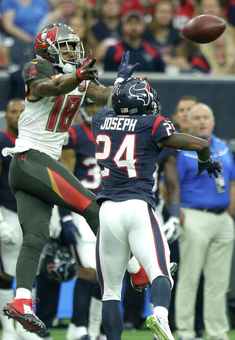 Houston Texans cornerback Johnathan Joseph (24) breaks up a pass intended for Tampa Bay Buccaneers wide receiver Louis Murphy (18) during the second quarter of an NFL football game at NRG Stadium on Sunday, Sept. 27, 2015, in Houston. ( Brett Coomer / Houston Chronicle ) Photo: Brett Coomer, Staff / Houston Chronicle / © 2015  Houston Chronicle