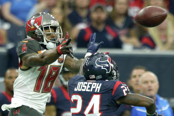 Houston Texans cornerback Johnathan Joseph (24) breaks up a pass intended for Tampa Bay Buccaneers wide receiver Louis Murphy (18) during the second quarter of an NFL football game at NRG Stadium on Sunday, Sept. 27, 2015, in Houston. ( Brett Coomer / Houston Chronicle )