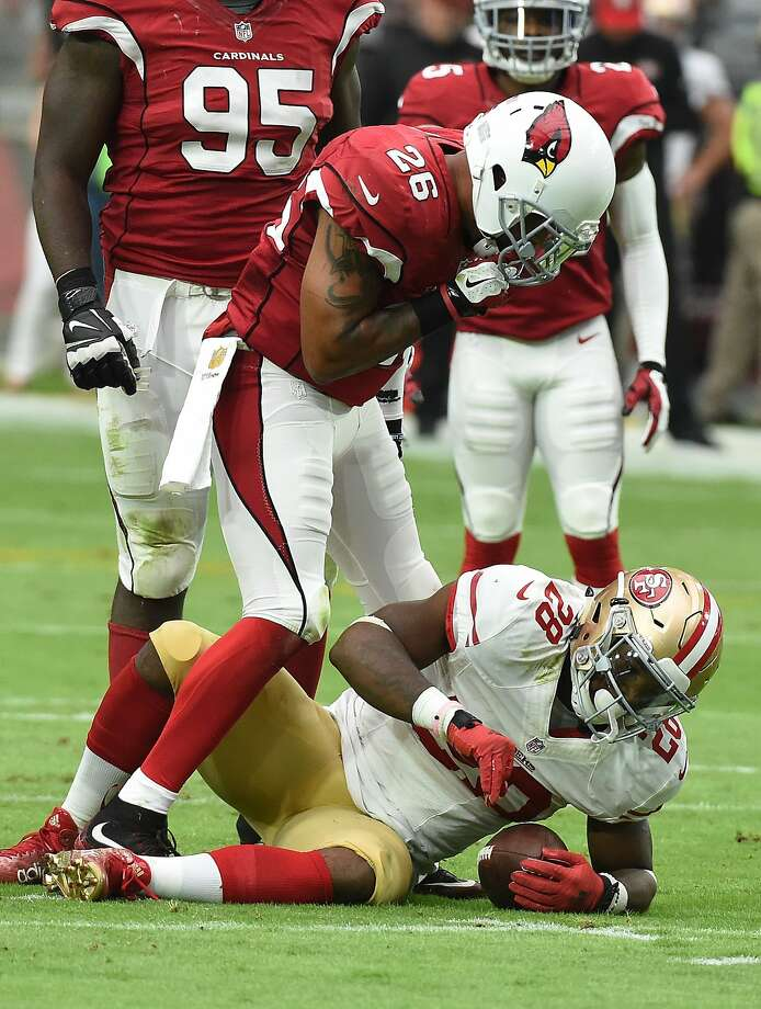 Arizona's Rashad Johnson stands over the 49ers' Carlos Hyde. Photo: Norm Hall, Getty Images