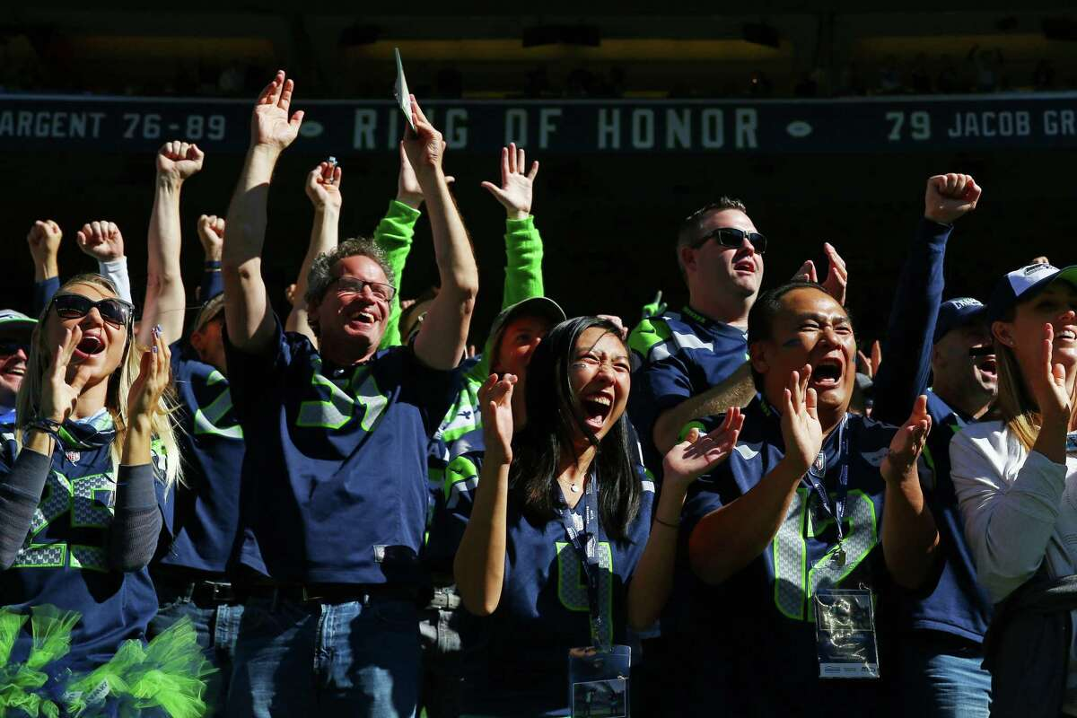 Fans cheer after Richard Sherman ran the ball for a 64 yard gain in the first quarter of the Seahawks home opening game against Chicago at CenturyLink Field, Sunday, September 27, 2015. The Seahawks won 26-0.