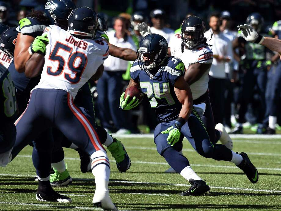 Running back Thomas Rawls of the Seattle Seahawks runs with the ball during the first quarter of the game against the Chicago Bears at CenturyLink Field on September 27, 2015 in Seattle, Washington. Photo: Steve Dykes, Getty Images / 2015 Getty Images