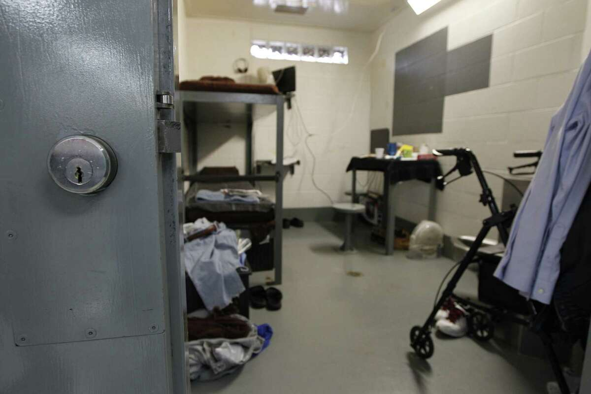 A walker sits in a room at the Billy Clayton Center in Littlefield, the state's new home for convicted sex predators who have completed their prison sentences. Below, Clarence Brown, a resident, talks to a reporter.