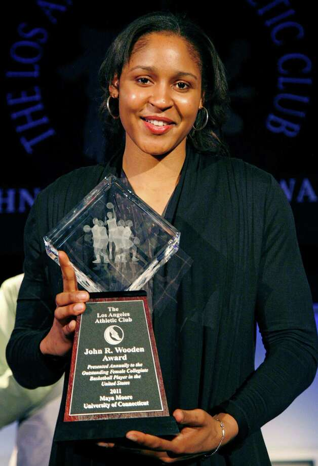 Maya Moore of the University of Connecticut poses with her trophy after winning the women's John Wooden Award during the award ceremony Friday, April 8, 2011, in Los Angeles. (AP Photo/Jason Redmond) Photo: Jason Redmond / FR74394 AP