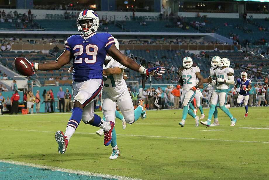 MIAMI GARDENS, FL - SEPTEMBER 27:  Karlos Williams #29 of the Buffalo Bills scores a touchdown during a game against the Miami Dolphins at Sun Life Stadium on September 27, 2015 in Miami Gardens, Florida.  (Photo by Mike Ehrmann/Getty Images) ORG XMIT: 567117155 Photo: Mike Ehrmann / 2015 Getty Images