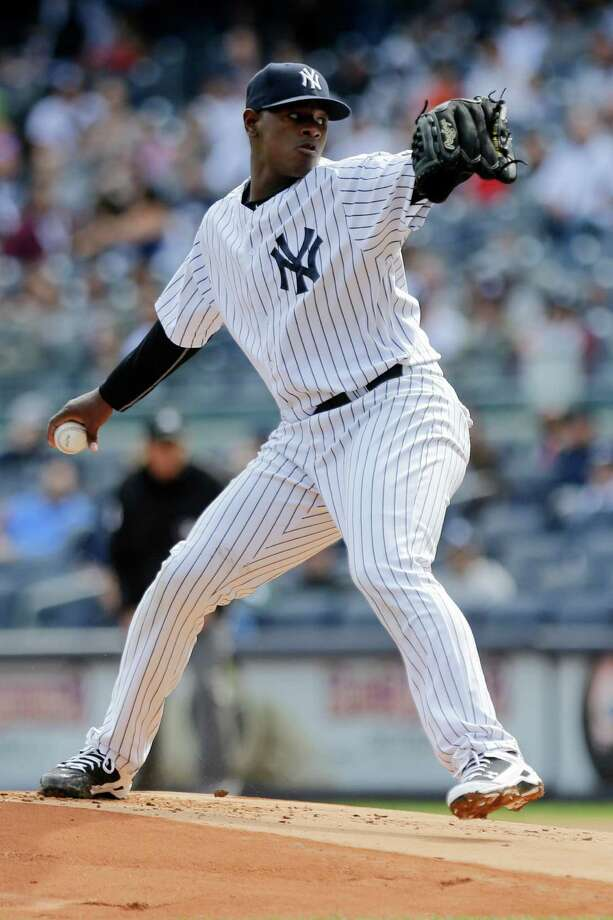 New York Yankees' Luis Severino delivers a pitch during the first inning of a baseball game against the Chicago White Sox, Sunday, Sept. 27, 2015, in New York. (AP Photo/Frank Franklin II) ORG XMIT: NYY103 Photo: Frank Franklin II / AP
