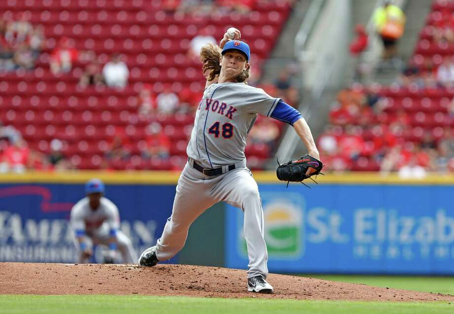 New York Mets starting pitcher Jacob deGrom delivers in the first inning of a baseball game against the Cincinnati Reds, Sunday, Sept. 27, 2015, in Cincinnati. (AP Photo/Aaron Doster) ORG XMIT: OHAD104 Photo: Aaron Doster / AP