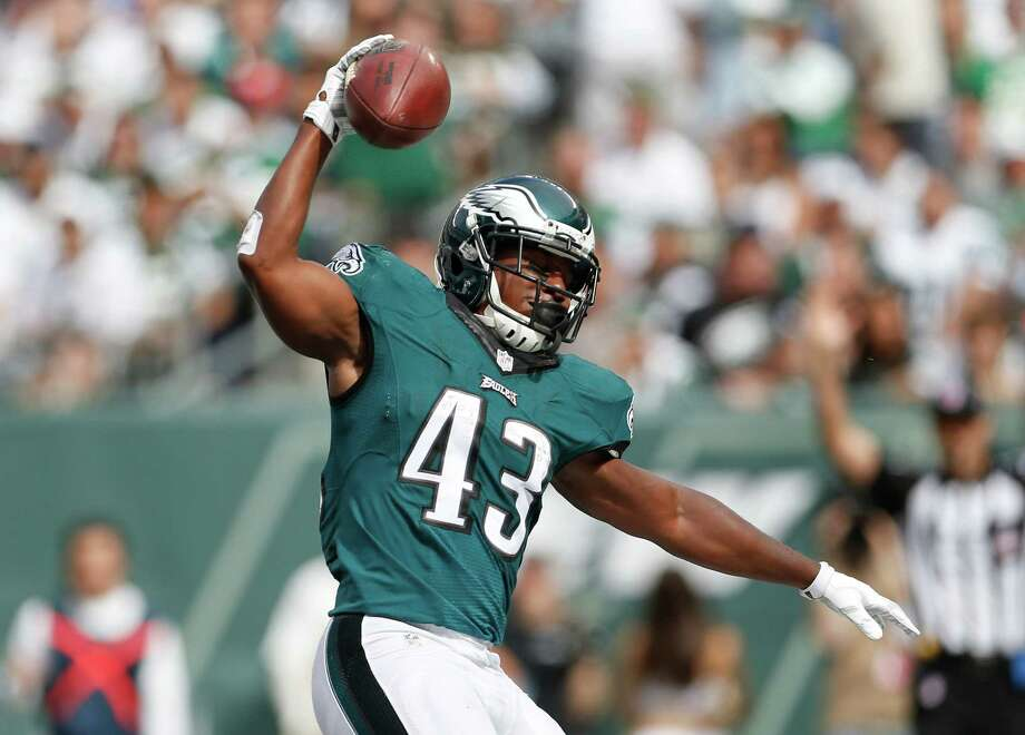 Philadelphia Eagles running back Darren Sproles (43) reacts after scoring a touchdown against the New York Jets during the second quarter of an NFL football game, Sunday, Sept. 27, 2015, in East Rutherford, N.J. (AP Photo/Adam Hunger)  ORG XMIT: ERU116 Photo: Adam Hunger / FR110666 AP