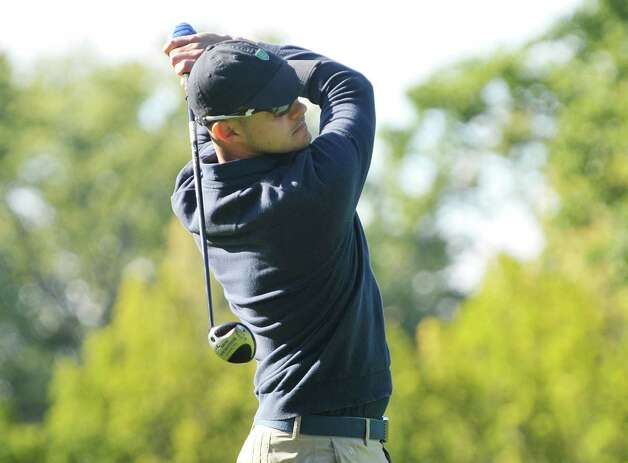 Golfer Adam Condello tees off during the final round of the New York State Golf Association Mid-Amateur Golf Tournament at Wolferts Roost Country Club on Sunday, September 27, 2015, in Albany, NY  (Paul Buckowski / Times Union) Photo: PAUL BUCKOWSKI / 00031866C