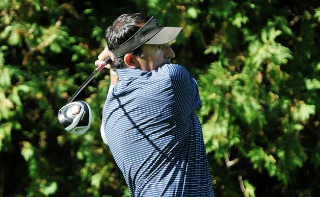 Golfer Luke Hobika hits a tee shot during the final round of the New York State Golf Association Mid-Amateur Golf Tournament at Wolferts Roost Country Club on Sunday, September 27, 2015, in Albany, NY  (Paul Buckowski / Times Union) Photo: PAUL BUCKOWSKI / 00031866C