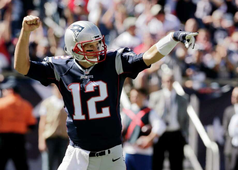 New England Patriots quarterback Tom Brady celebrates a touchdown run by running back Dion Lewis in the first half of an NFL football game Jacksonville Jaguars , Sunday, Sept. 27, 2015, in Foxborough, Mass. (AP Photo/Charles Krupa)  ORG XMIT: FBO106 Photo: Charles Krupa / AP