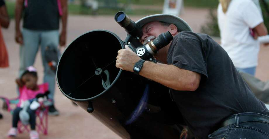 Keith Little checks out his 19 in dobsonion telescope. Lunar Extravaganza! A viewing event for the ÒHarvest MoonÓ lunar eclipse Hosted by the Scobee Education Center at San Antonio College on Sunday, September 27, 2015 Photo: Ron Cortes, Freelance / For The San Antonio