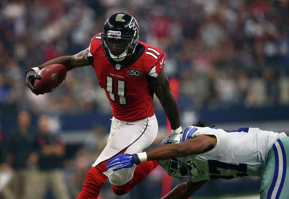 Falcons receiver Julio Jones gets past the Cowboys'  J.J. Wilcox on one of his two touchdown receptions. Photo: Ronald Martinez, Staff / 2015 Getty Images