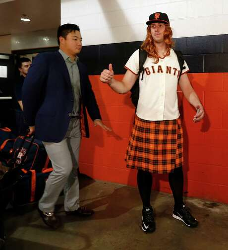 Matt Duffy, right, was one of the Astros' rookies who had to travel to Seattle in costume, with his kilt and Giants jersey ensemble an homage to the San Francisco rookie of the same name. Photo: Karen Warren, Staff / © 2015 Houston Chronicle