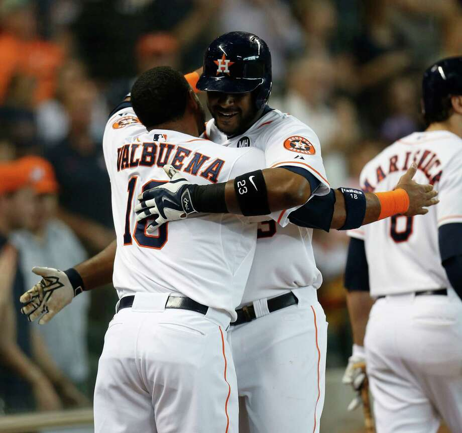 Luis Valbuena greets Chris Carter after Carter's seventh-inning homer provided the Astros with a much-needed insurance run. Photo: Karen Warren, Staff / © 2015 Houston Chronicle