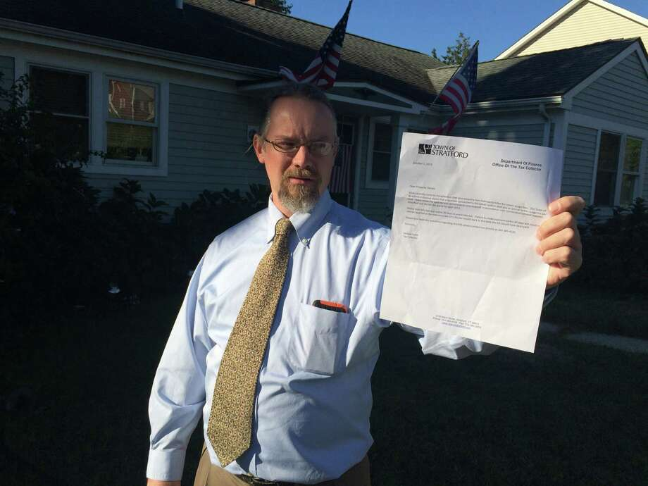 "Mark Scheck, who lives on Birdseye Street in Stratford, Connecticut, seen here in this photo taken on Sept. 24, 2015, was one of the 700-plus homeowners in town who's upset over getting a second sewer bill last week, which he's holding here. ""The mayor is going to see a huge backlash from this, "" he said. Photo: John Burgeson /Connecticut Post / Connecticut Post"