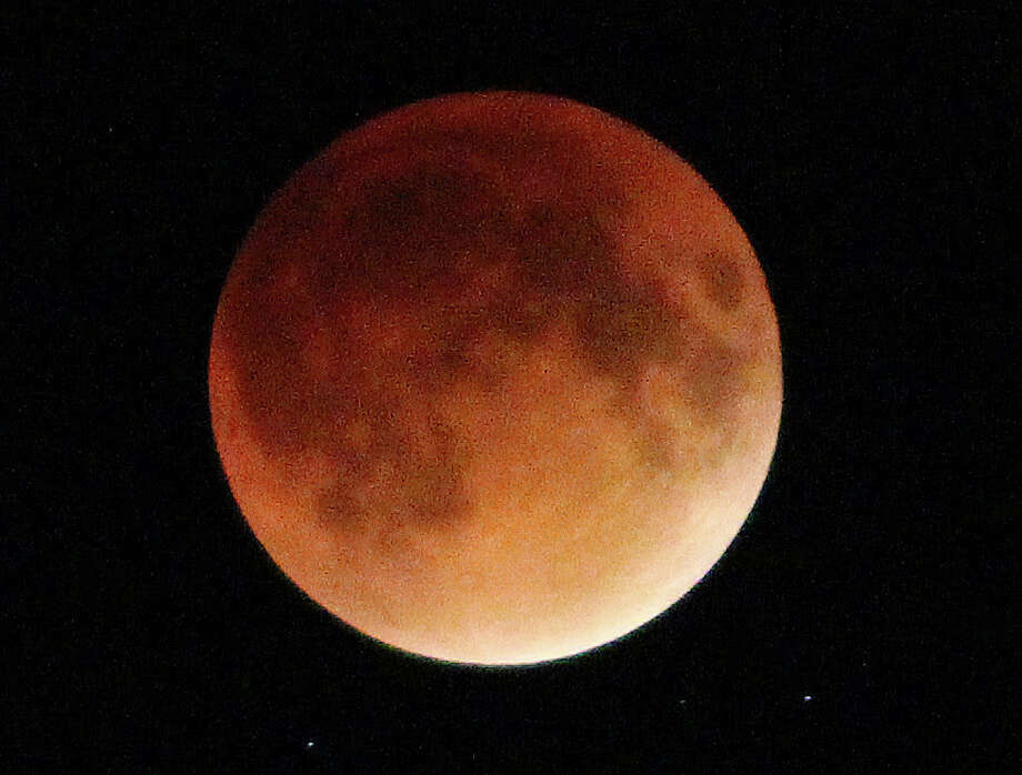 This image the super moon lunar eclipse was photographed Sunday night over Compo Beach. Photo: Mark Mathias / Mark Mathias / Westport News