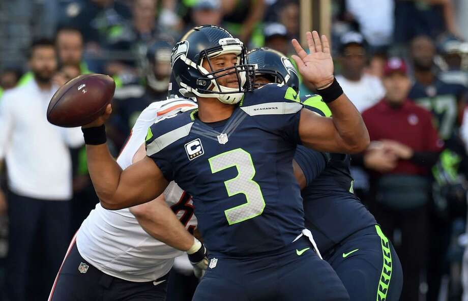 Quarterback: After being under almost constant pressure for most of the first half, Russell Wilson finally got a little time to operate in the Hawks' final drive of the half. Things got even better in the second half, when Wilson was 11-of-16 passing for 140 yards, including a 30-yard touchdown to Jimmy Graham. He could have had another long touchdown to Tyler Lockett in the fourth quarter had the ball not been dropped, and he used his legs sparingly, but effectively. Not perfect, but a good game from Wilson. Grade: B+ Photo: Steve Dykes, Getty Images / 2015 Getty Images