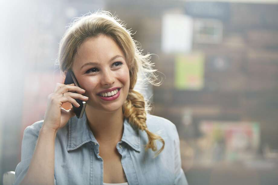 A woman hates being stuck on the phone with her chatty girlfriend. Photo: Oli Kellett