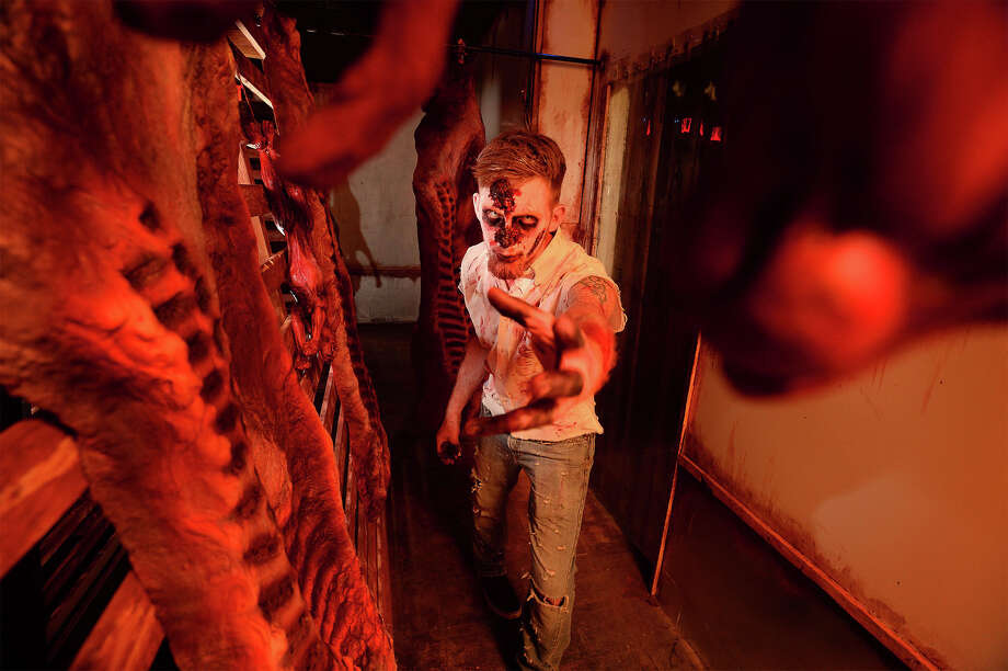 Justin Lopez in the meat locker at the Haunted Hotel in Beaumont. The 'boo' filled business opened Friday downtown and plans its last scare Halloween night.  