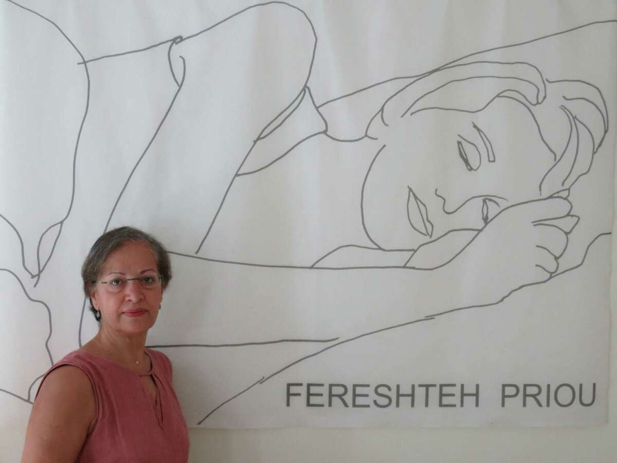 Greenwich artist Fereshteh Priou, with one of her drawings, is having a show of her work at Les Beaux Arts Gallery in Greenwich through Thursday, Oct. 15.
