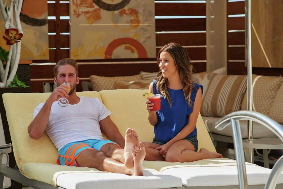 Shawn Booth and Kaitlyn Bristowe lounging at the private pool at The Villas at The San Luis. Photo: Kennon Evett                   , Kennon Evett