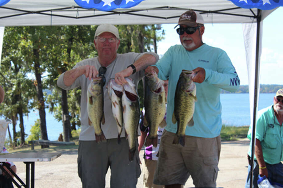 Bill Rogers and Ricki Y'Barbo tie for first place with sacks of 24.04 lbs. photo by Terry Sympson