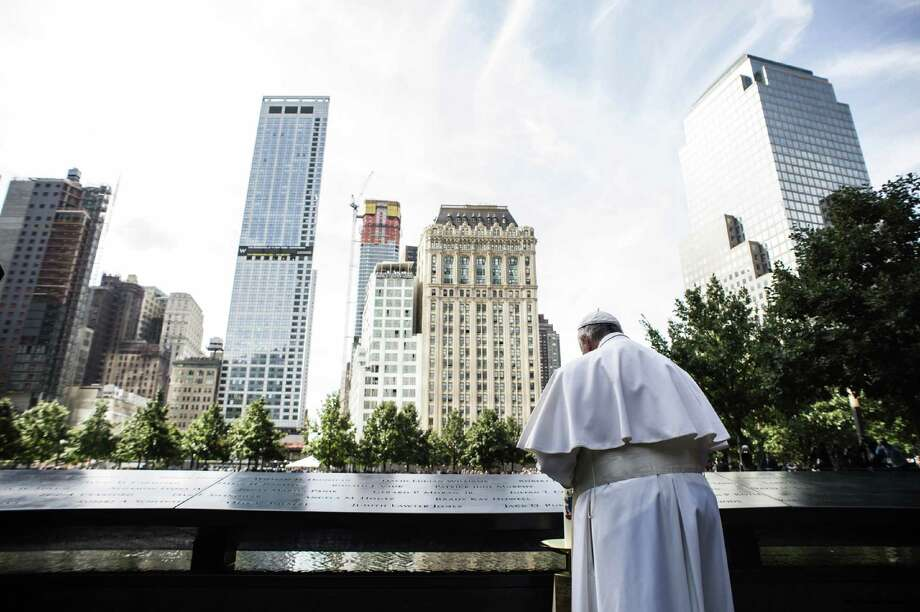 In this photo taken on Friday, Sept. 25, 2015 Pope Francis visits the Sept. 11 Memorial Museum at ground zero in New York. (L'Osservatore Romano/Pool Photo via AP) Photo: Associated Press / L'Osservatore Romano
