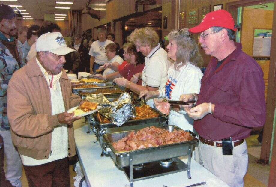 Volunteers feed vets during a previous Homeless Veterans Stand-Down at the Colonie Elks in Latham. The event is held by the Eastern New York State Homeless Veterans Coalition. (Photos courtesy of Colonie Elks Lodge)
