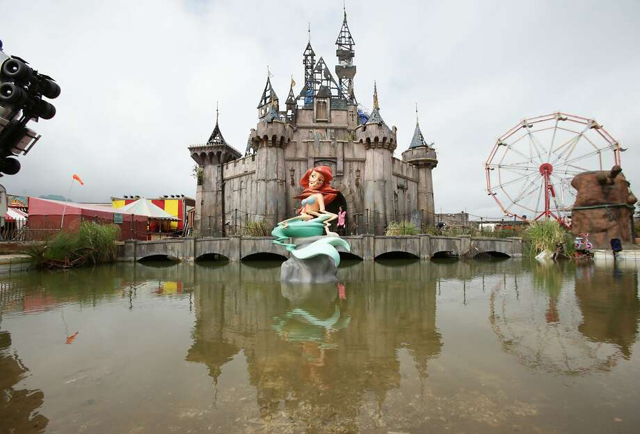 """Dismaland,"" Banksy's anarchic amusement park in the faded English resort town of Weston-Super-Mare, satirized consumerism and entertainment tourism. Photo: Yui Mok, Associated Press"