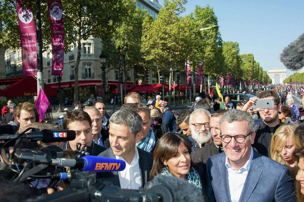 Christophe Najdovski, left, in charge of Paris transportation, Anne Hidalgo, Mayor of Paris and Yvan Mayeur, Mayor of Brussels talk to the press during the car free day on Sept. 27 in Paris. Between 11 a.m. and 6 p.m. central Paris went car-free. Private cars with petrol or diesel engines are banned and only electric powered private vehicles were allowed in an attempt to persuade residents to tackle pollution.