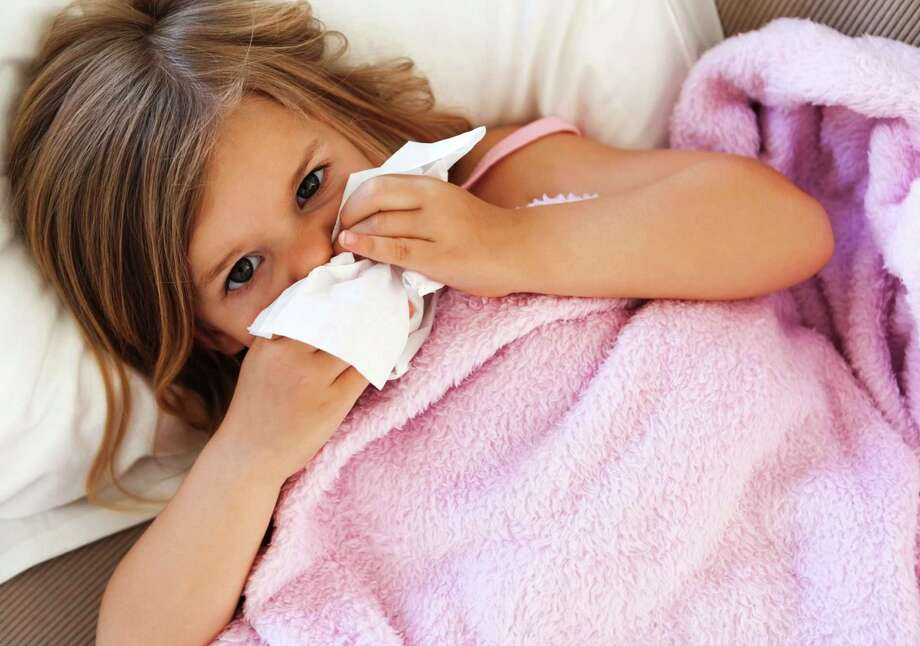 Most school districts have policies meant to keep the truly sick kids at home, including those with contagious illnesses such as strep throat, and those who have experienced vomiting or a fever. Photo: Tribune News Service