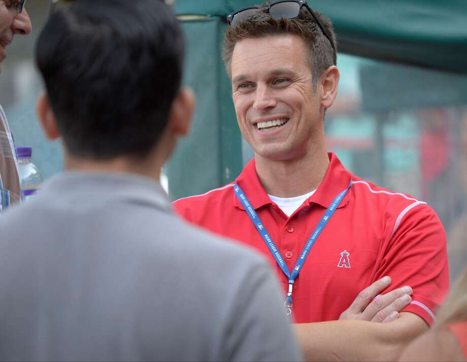 Jerry Dipoto speaks to the media before the game against the Los Angeles Dodgers on August 7, 2014 at Angel Stadium of Anaheim in Anaheim, California. (Photo by Matt Brown/Getty Images)